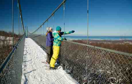 Scenic Caves Walk - 2 women walking across suspension bridge in Winter