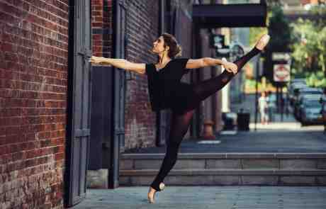 Ballet dancer with leg stretched in the air practicing dancing