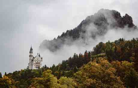 neuchwanstein castle in misty mountains